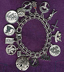Vintage STERLING CHARM BRACELET with 16 CHARMS